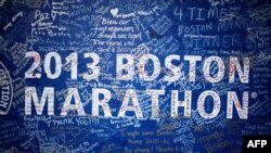 Signatures adorn a Boston Marathon poster near the site of the Boston Marathon bombings in Boston.