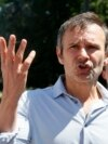 Svyatoslav Vakarchuk, a Ukrainian singer who has recently established a political party, gestures as he talks to reporters in front of the parliament building in Kyiv on June 25.