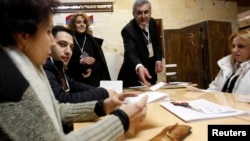 Armenia -- Election officials count ballots after polls closed at a polling station in Yerevan, 18Feb2013