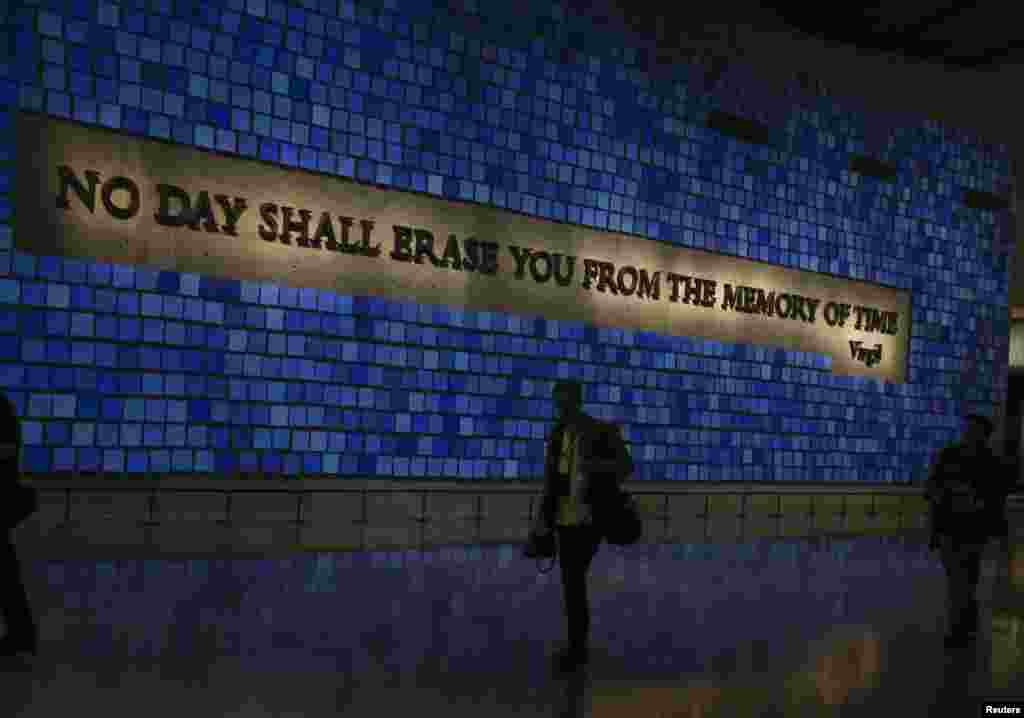 A memorial wall featuring panels for the 2,983 victims of the attacks