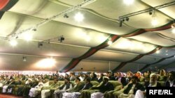 Afghan delegates at a previous Loya Jirga, or grand assembly, listen to a speech by Afghan President Hamid Karzai at that June 2010 event.