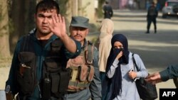 FILE: Afghan police helpping civilians after a militant attack in the capital, Kabul.