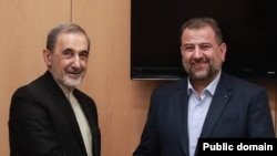 Ali Akbar Velayati, a top adviser to Iran's Supreme Leader Ayatollah Ali Khamenei meeting with Salih al-Arouri, the deputy chairman of the political office of Palestinian group Hamas. July 23, 2019