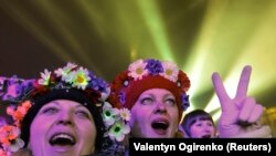 "Demonstrators supporting Ukraine's integration with Europe celebrate the New Year on Kyiv's Independence Square, or Maidan, on January 1. The mass ""Euromaidan"" demonstrations that began in November led to the ouster of President Viktor Yanukovych three months later. (Valentyn Ogirenko, Reuters)"