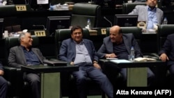 Abdolnaser Hemmati (center), Governor of the Central Bank of Iran, listens to a speech over the a bill to counter terrorist financing in parliament in Tehran, October 7, 2018