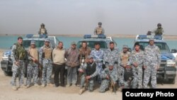 Nature Iraq's Omar Fadhel (center) and his colleagues are accompanied by troops on a recent survey in western Iraq.