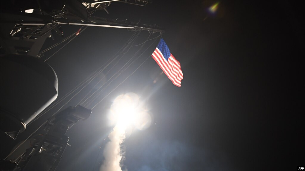 An image released by the U.S. Navy shows the guided-missile destroyer USS Porter conducting cruise-missile strikes against the Shayrat Airfield in Syria on April 7.