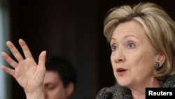 "U.S. Secretary of State Hillary Clinton told the Senate Foreign Relations Committee that ""Iran is at the top"" of her agenda these days as international momentum for sanctions increases."