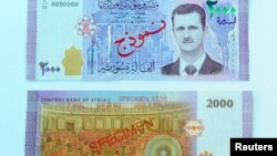 Банкнота номиналом 2000 сирийских фунтов с изображением президента Башара Асада.
