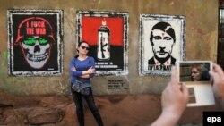 Граффити стрит-арт-художника Sociopath «Трилогия войны». Львов, 9 мая 2014 года