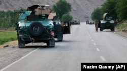 Afghan soldiers near the city of Badakhshan in northern Afghanistan on July 4. Afghanistan's Badakhshan Province borders Tajikistan.