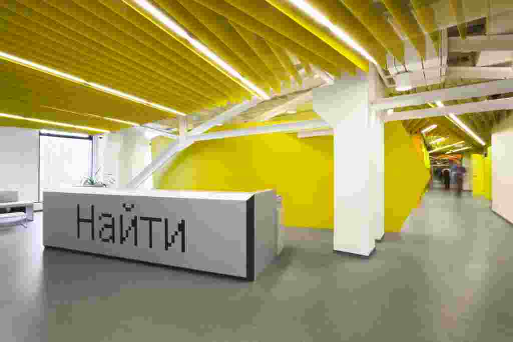 "Visitors to Yandex's offices in St. Petersburg are greeted by the search engine's trademark yellow color and ""Search"" button."