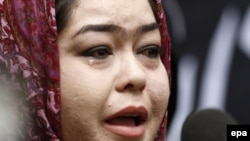 An Afghan woman cries during a protest in Kabul as she condemn the killing of Afghan civilians from Hazara minority, who were allegedly killed by the Islamic State (IS) militants in Zabul province.