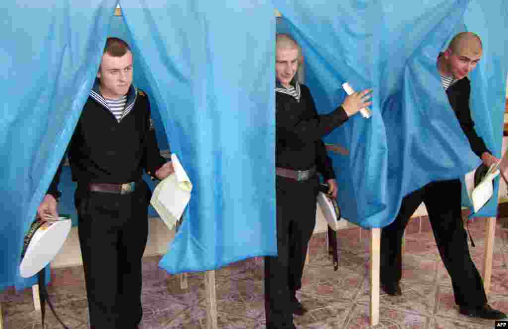 Navy sailors leave the voting booth in Sevastopol.