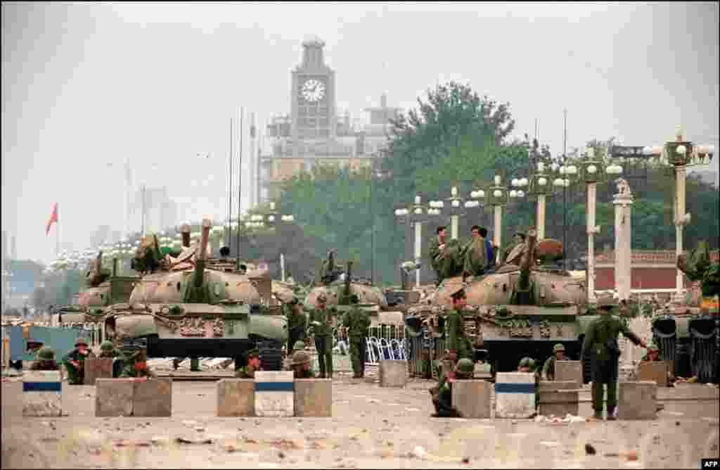Tanks guard a strategic avenue leading to Tiananmen Square on June 6 after protesters had been cleared from the area.