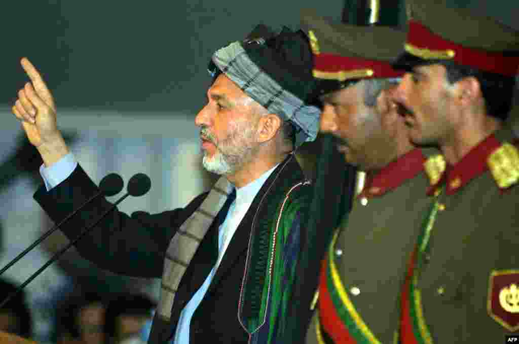 Karzai speaks during an emergency Loya Jirga, or grand assembly, in Kabul on June 19, 2002, during which he was chosen for a two-year term as interim president of the Afghan transitional government.