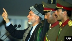 File photo of former Afghan President Hamid Karzai speaking during the Loya Jirga in 2002.