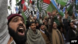 Activists of Pakistani Islamist groups and political parties shout slogans during an anti-U.S. rally in Islamabad on February 20.