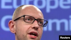 "Ukrainian Prime Minister Arseniy Yatsenyuk said he would not negotiate with ""terrorists"" unless they laid down their arms."