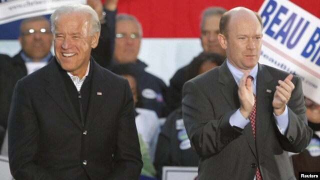 U.S. Democratic Senator Chris Coons (right) with Vice President Joe Biden (file photo)