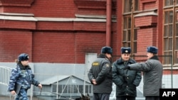Prosecutors say the gang used intimate knowledge of Russian police protocol to carry out the crimes. (file photo)