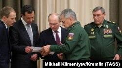 Президент Сирии Башар Асад, Путин, Шойгу (в центре)