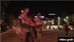 Kosovar police cordon off the area around the parliament in Pristina after two rocket-propelled grenades hit the building late on August 4. (file photo)