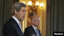 U.S. Secretary of State John Kerry (left) and British Foreign Secretary William Hague hold a joint news conference in central London on February 25.