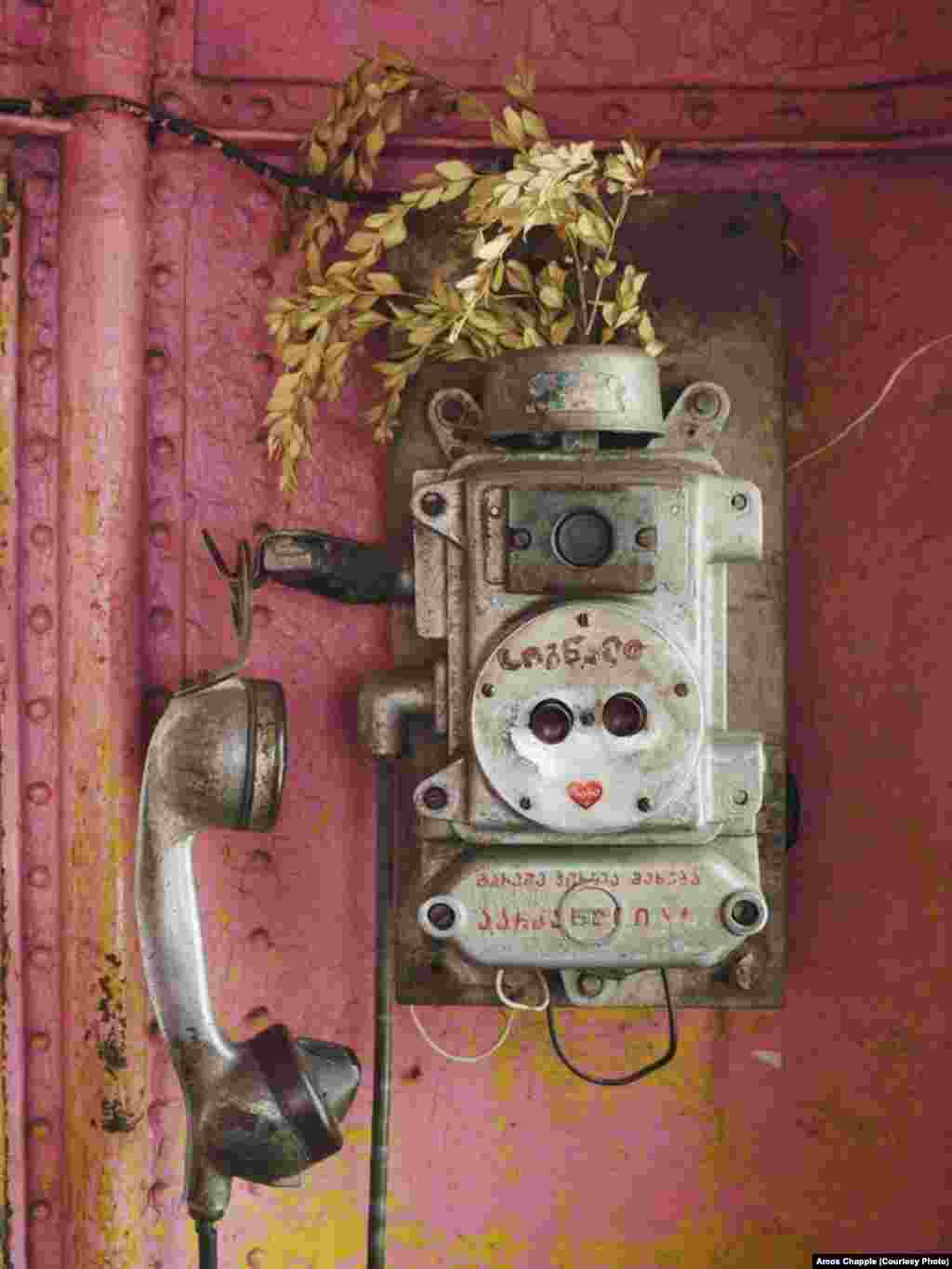 A telephone inside a cabin of Tramway 25