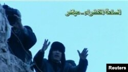 Libyan leader Muammar Qaddafi addresses a crowd gathered in Tripoli's Green Square in this still image taken from video broadcast on Libyan state television on February 25.