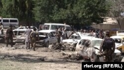 Vehicles destroyed by the blast in Khost on May 27