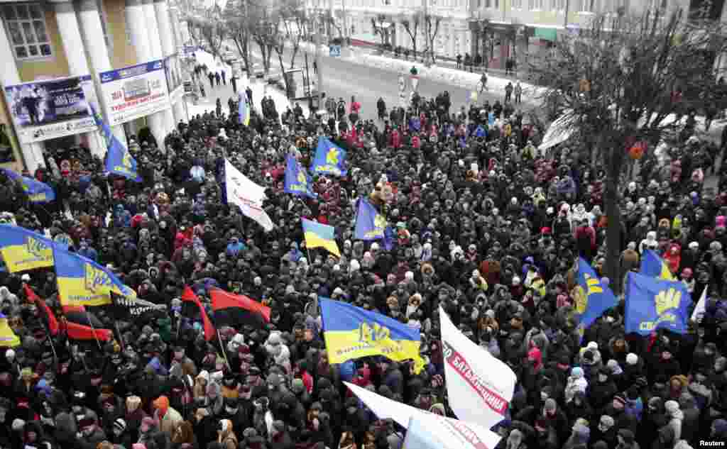 Antigovernment protesters hold a rally near the regional administration headquarters in Vinnytsia.