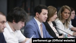 The speaker of the Georgian parliament, Archil Talakvadze (center), presents amendments to the constitution and the Electoral Code in Tbilisi on August 5.
