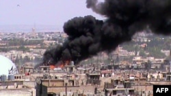 Syria -- Smoke rises from a building in the Khalidiyah neighbourhood of the restive city of Homs, 08Jun2012
