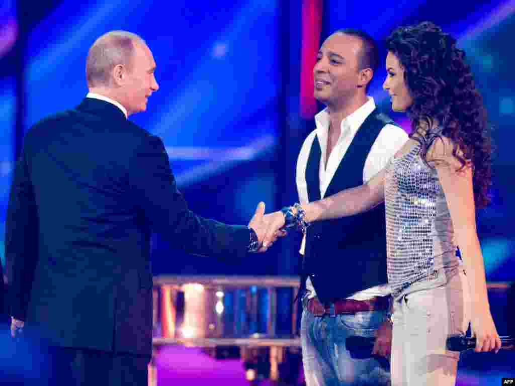 "Russian President Vladimir Putin was seen as closely supervising Moscow's lavish preparations to host the competition in 2009. One analyst remarked that Putin saw Eurovision as a chance to promote ""national dignity."" Here, the president meets Azerbaijan's contenders, Arash (center) and AySel (right)."