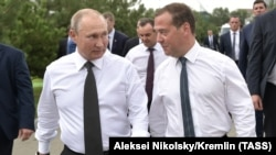 Russian President Vladimir Putin (left) and Prime Minister Dmitry Medvedev visit the Black Sea town of Anapa in August.