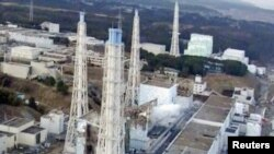 An aerial view shows damage sustained to the reactors at the Fukushima nuclear power complex.