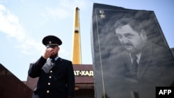 A Chechen police officer stands guard in front of the memorial for Akhmad Kadyrov, the father of current Chechen President Ramzan Kadyrov, in Grozny in July.