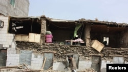 Destroyed houses after an earthquake hit the Tibetan Autonomous Prefecture of Yushu