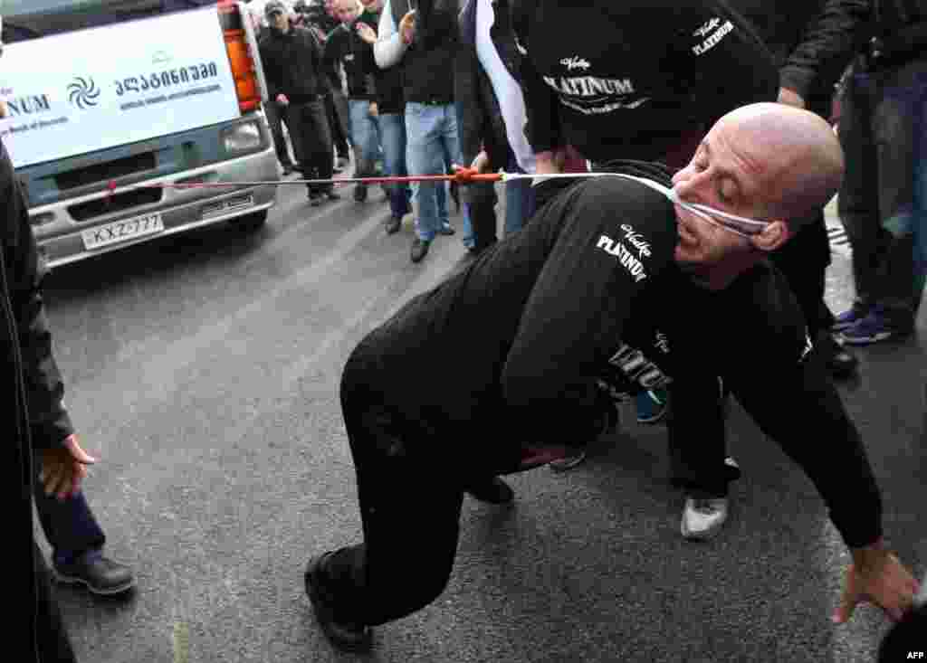 Lasha Pataraia pulls an 8-ton truck with his ear during an event in the Georgian city of Rustavi, outside Tbilisi, on November 29. The 32-year-old Georgian athlete broke a Guinness record after he managed to pull the truck with his ear for 21.5 meters. (AFP/Vano Shlamov)