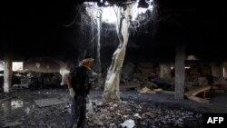 Зруйнована будівля в Сані внаслідок повітряного удару 8 жовтня 2016 року