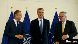 Старшыня Эўрапейскай рады Дональд Туск, Генэральны сакратар НАТО Енс Столтэнберг, кіраўнік Эўракамісіі Жан-Клёд Юнкер.