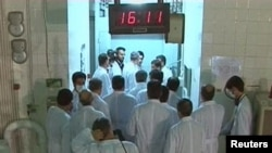 A group of Iranian scientists near the control room area at the Tehran Research Reactor in a February 15 photo.
