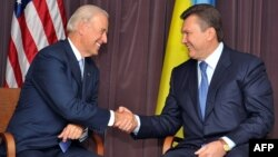 U.S. Vice President Joe Biden (left) at a 2009 meeting with Viktor Yanukovych, who was then in the opposition, in Kyiv