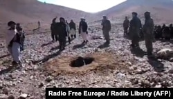 A video grab shows Afghan men stoning Rokhshana to death in Ghor Province in October 2015.