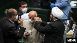 Members of the new Iranian parliament wearing masks. Undated