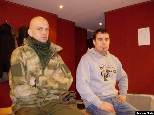 "Sergei Maksimov (left), known as ""Silver,"" returned from eastern Ukraine after sustaining serious battlefield injuries. Andrei Dmitriev (right) is the head of Other Russia's St. Petersburg branch."