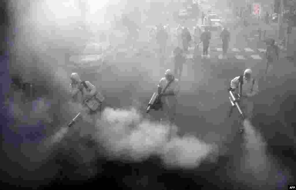 Iranian firefighters disinfect streets in the capital, Tehran, in a bid to halt the wild spread of coronavirus.