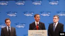 U.S. President Barack Obama is flanked by French President Nicolas Sarkozy (left) and British Prime Minister Gordon Brown on the second day of the G-20 summit in Pittsburgh.