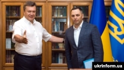Ousted Ukrainian President Viktor Yanukovych (left) and his former deputy chief of staff, Andriy Portnov, in 2010